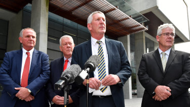 Joe, John, Dennis and Neill Wagner speak to the media outside the Supreme Court after the verdict in their defamation proceedings against Alan Jones.
