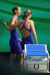 Emma McKeon, left, and Ariarne Titmus leave the pool deck after the 200m freestyle final.
