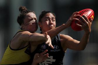 Darcy Vescio, right, and Harriet Cordner compete for the ball.