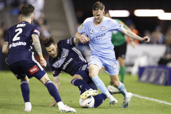 Melbourne City's Craig Noone, right, and James Donachie contest the ball.