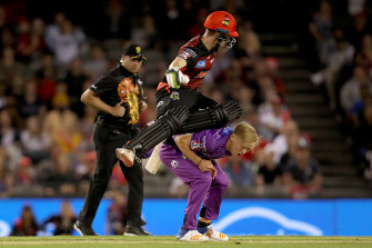 Sam Harper tries to leap over Nathan Ellis.