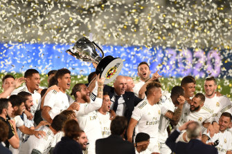 Captain Sergio Ramos lifts the cup as Real Madrid celebrate taking the La Liga title.