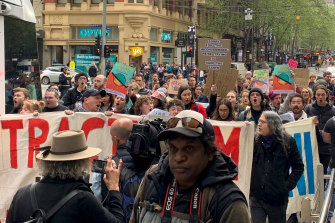 XR activists marched down Collins Street on Friday morning.
