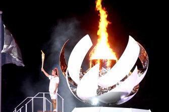 Tennis player Naomi Osaka lights the Olympic cauldron to kick off the Tokyo Games.