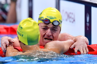 Grant Patterson left, and Ahmed Kelly, both of Australia, embrace after finishing third and second respectively in the Men's SM3 150 metre Individual medley final at the Tokyo Aquatic Centre.