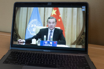Chinese Foreign Minister Wang Yi, seen on a computer monitor delivering a remote address to the UN.