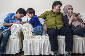 Ablet Abdugani with his daughter Serife, 15, right, and his sons Abdussalam, 11, and Abdullah, five, at home in Istanbul.