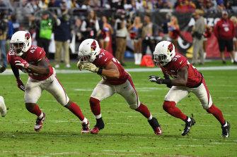 Arizona's Haason Reddick, Ezekiel Turner and Chris Banjo attempt to block a punt against the Rams.