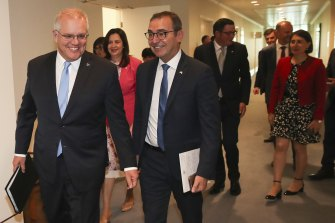 Scott  Morrison with state and territory leaders after the first in-person national cabinet meeting in December.