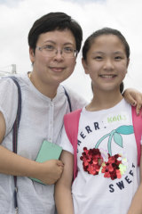 Natalie Li, right, with her mum Kitty, following the exams on Sunday.