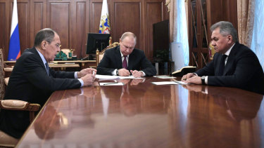 President Vladimir Putin at a meeting with Foreign Minister Sergey Lavrov (left) and Defence Minister Sergei Shoigu (right) in the Kremlin.