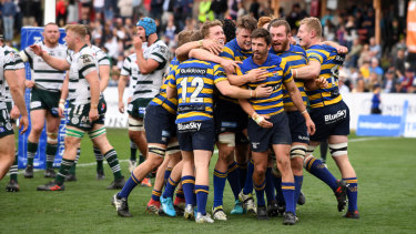 Drought over: The Students celebrate a Jake Gordon try against the Rats in the Shute Shield final.