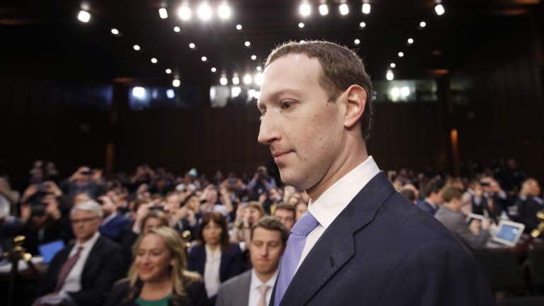 Facebook CEO Mark Zuckerberg arrives to testify before a joint hearing of Congress.