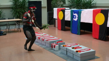 A Yawuru man performs at the repatriation ceremony at the Australian embassy in Berlin.