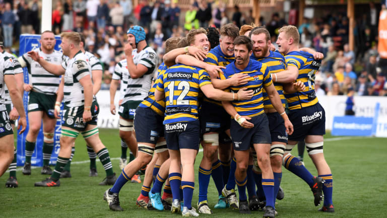 Drought over: The Students celebrate a Jake Gordon try in the Shute Shield final.