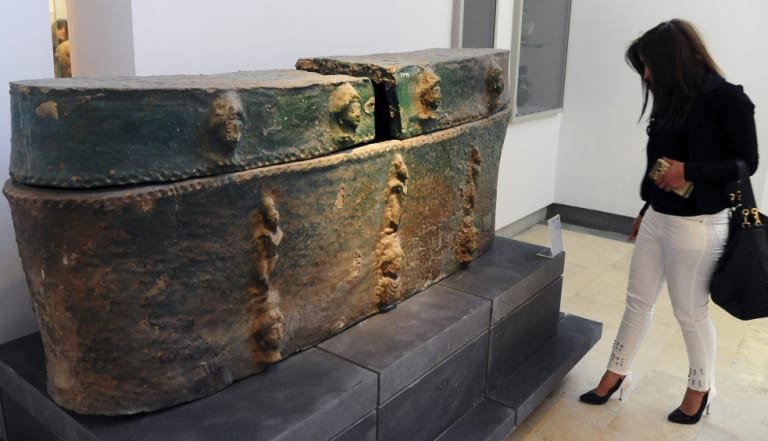 This photo released by the Syrian official news agency shows a visitor looking at ancient artefacts during the reopening ceremony for Syria's National Museum of Damascus.