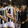 Magpies coach Nathan Buckley talks to his players during Saturday night's clash.