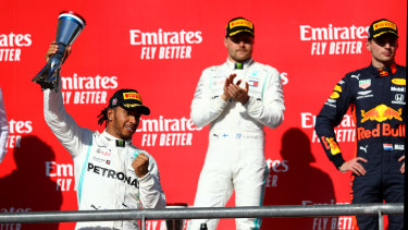 Lewis Hamilton (left) won his third F1 title in succession and sixth overall in the USA this month.