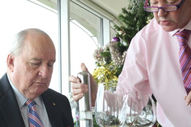 "Alan Jones hosting one of his regular lunches at the Bennelong apartments in 2014 being  ""peppered"" by his former butler David Allan."