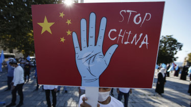 A protester from the Uighur community living in Turkey holds an anti-China placard during a protest in Istanbul.