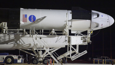A SpaceX Falcon 9 rocket with the company's Crew Dragon spacecraft is rolled out of the horizontal integration facility at Launch Complex 39A at NASA's Kennedy Space Center in Cape Canaveral, Florida.