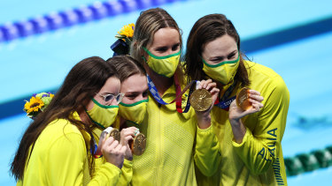 The women's medley relay winners display their gold medals.