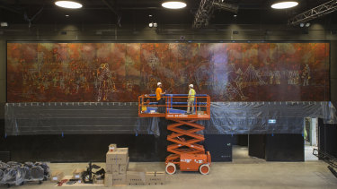 Staff from Abode Restoration and International Conservation Service install Sidney Nolan's <i>Eureka Stockade</i> in the Cultural Centre in ANU's new Kambri precinct.