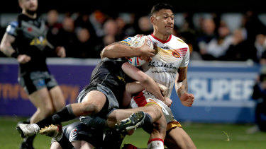 Folau is brought down by the Castleford defence.