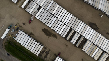Semi-truck trailers in the parking lot of the JBS Beef Production Facility in Greeley, Colorado.