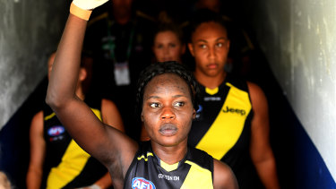 Living with racism: AFLW footballer Akec Makur Chuot doesn't take public transport for fear of being shunned.