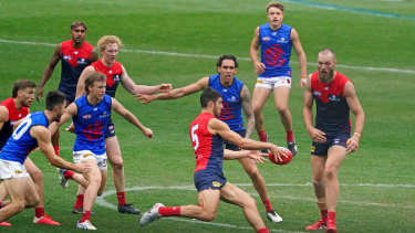 Kicking on: The Demons played an intraclub match at the MCG on Sunday after their round 3 fixture against the Bombers was postponed.