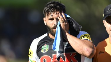 Josh Mansour clutches at his face in 2018.