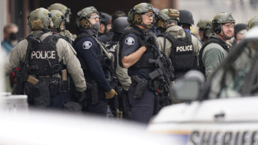 Police work on the scene outside a King Soopers grocery store where a shooting took place in Boulder, Colorado.