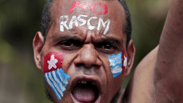 A Papuan activist with his face painted with the colours of the separatist Morning Star flag shouts slogans during a rally near the presidential palace in Jakarta last week.