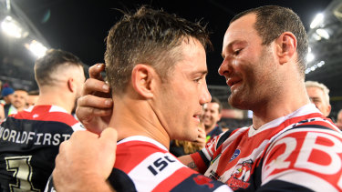 Storied episode: Cooper Cronk and Boyd Cordner embrace after the halfback's amazing feat of playing injured.
