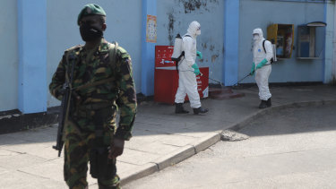 Police commandos prepare to spray disinfectant in a hospital in Colombo on March 27.