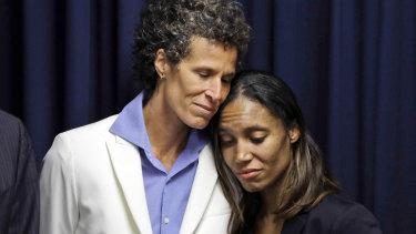 Victim Andrea Constand, left, embraces prosecutor Kristen Feden after the verdict in April.