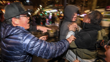 Rival protesters clash outside Melbourne's State Library.