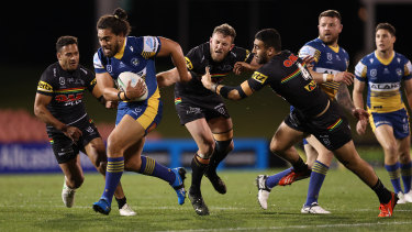 Parramatta Eels forward Isaiah Papali'i bursts through the Panthers defence earlier this year.