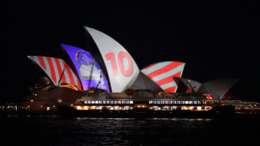 The barrier draw results for NSW Racing's multimillion-dollar race, The Everest, are projected onto the sails of the Opera House last October.