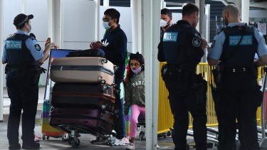 Passengers arrive at Sydney International Airport from Los Angeles off a United Airlines flight that arrived just after 6am on Thursday.