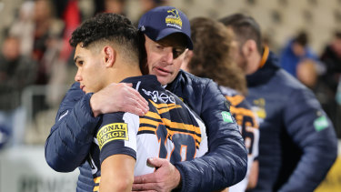 Assistant coach Rod Seib consoles Noah Lolesio after his missed kick that could have levelled the match.