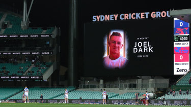 Players stand for a minute's silence in memory of Boyd Cordner's cousin Joel Dark before kick-off at the Sydney Cricket Ground.