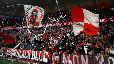 Wanderers supporters in full cry for the first derby at their new home.