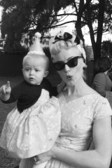 Sarah with her eldest daughter Maybelline, both wearing birdie dresses inspired by the frock handed down from sister to sister when Sarah was a child.