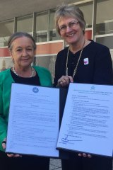 ACT Speaker Joy Burch and Northern Territory Speaker Kezia Purick with their petitions to Senate president Scott Ryan.