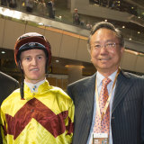 Boniface Ho with jockey Zac Purton at the Dubai World Cup.