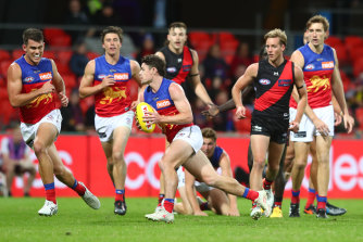 Lachie Neale breaks free as the Lions dominated the Bombers on Friday night.