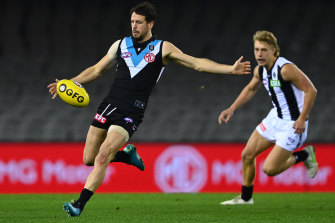 Travis Boak, in his 300th game, gets a kick away during Port Adelaide's win over Collingwood.