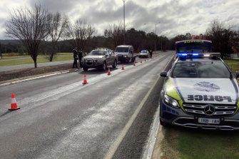 Police monitor cars entering Victoria at Wodonga on Friday.